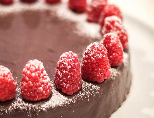 close up of Torta with raspberries.