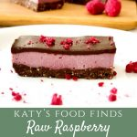 A slice of Raw Raspberry Chocolate Slice on a white plate with a sprinkling of freeze dried raspberries and 2 slices in background.
