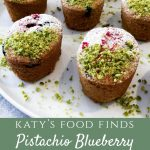 Close up of Pistachio Blueberry Friands topped with Crushed Pistachios and Icing Sugar.