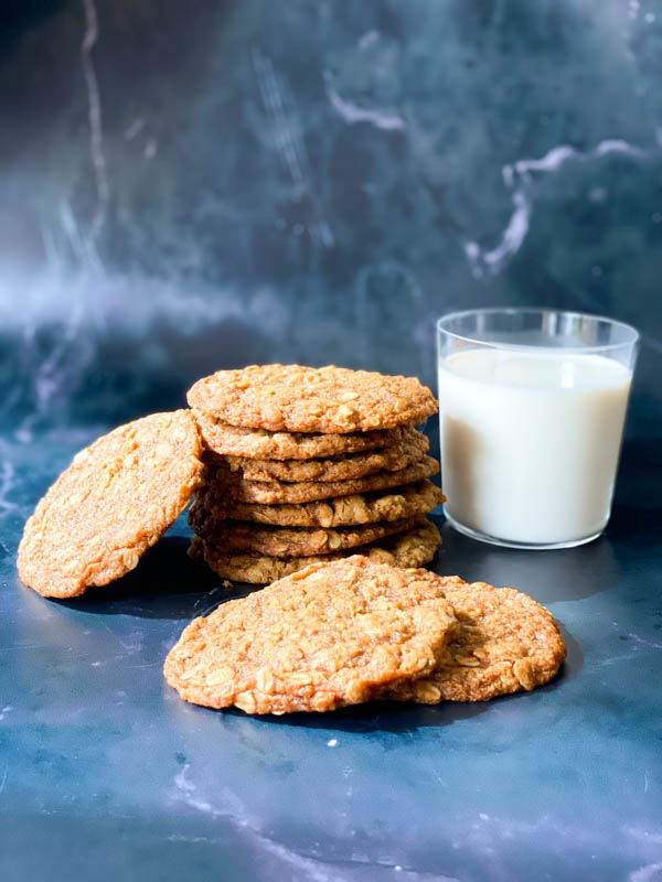 Anzac Biscuits with a glass of milk.