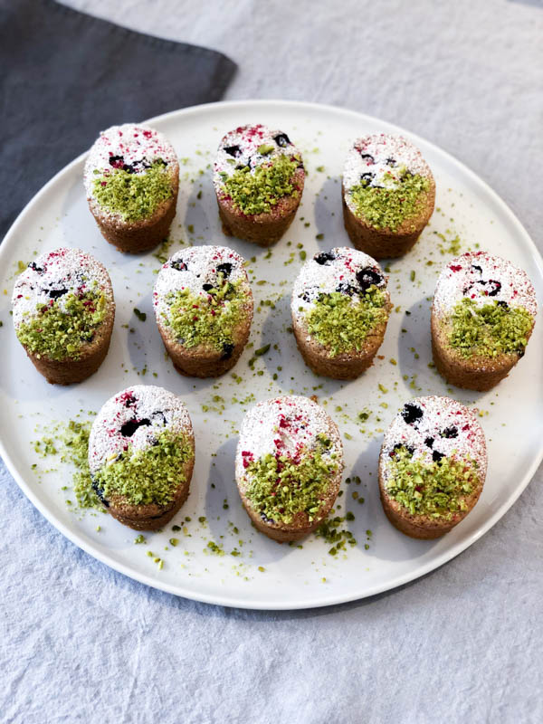 Looking down on a platter of Pistachio Blueberry Friands.