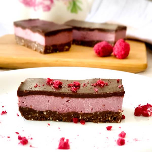 Raw Raspberry Chocolate Slice sprinkled with Freeze-Dried Rasoberries.