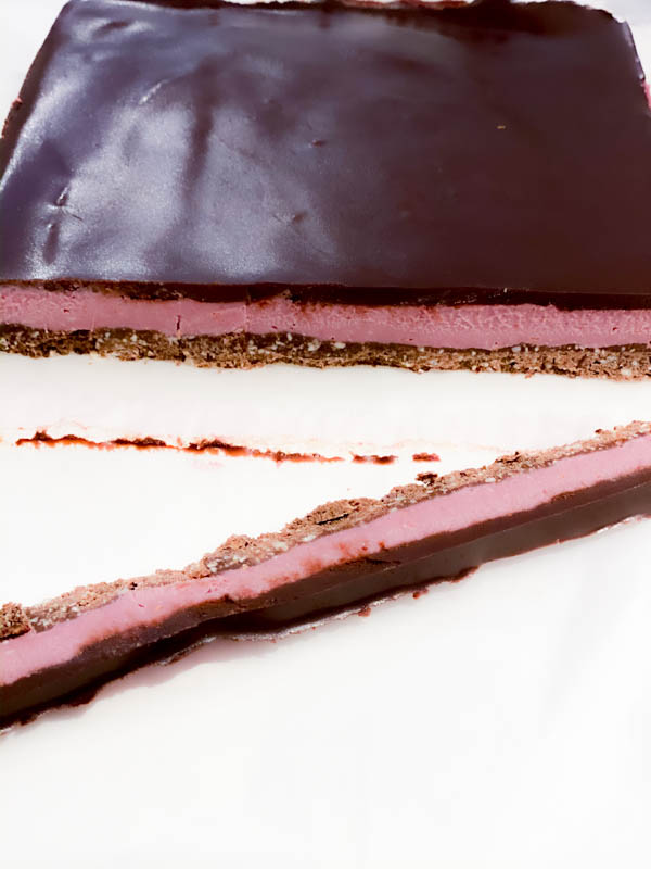 The slab of Raw Raspberry Chocolate Slice with an end trimmed off.