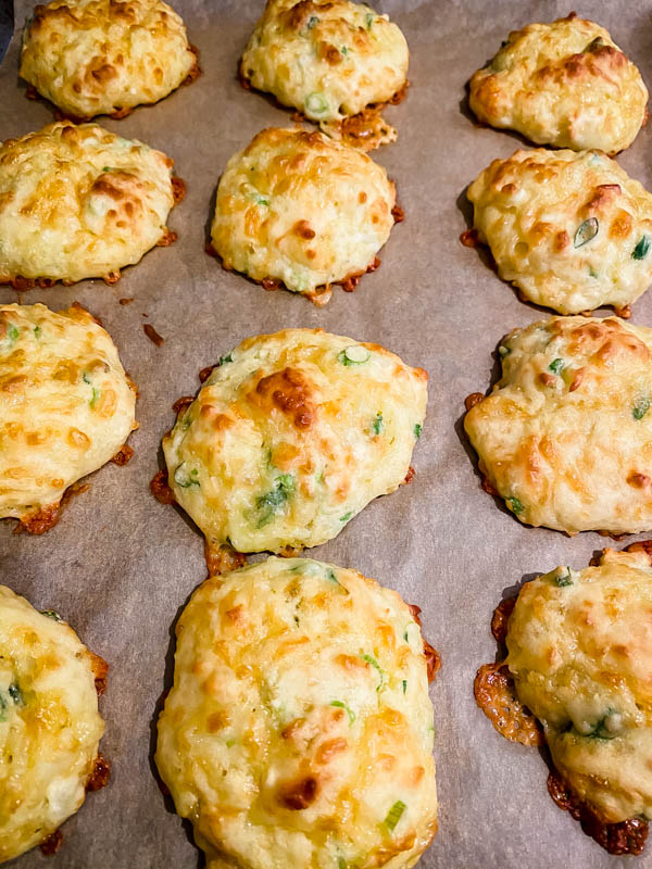 The baked Cheese Puffs are resting on the baking tray.