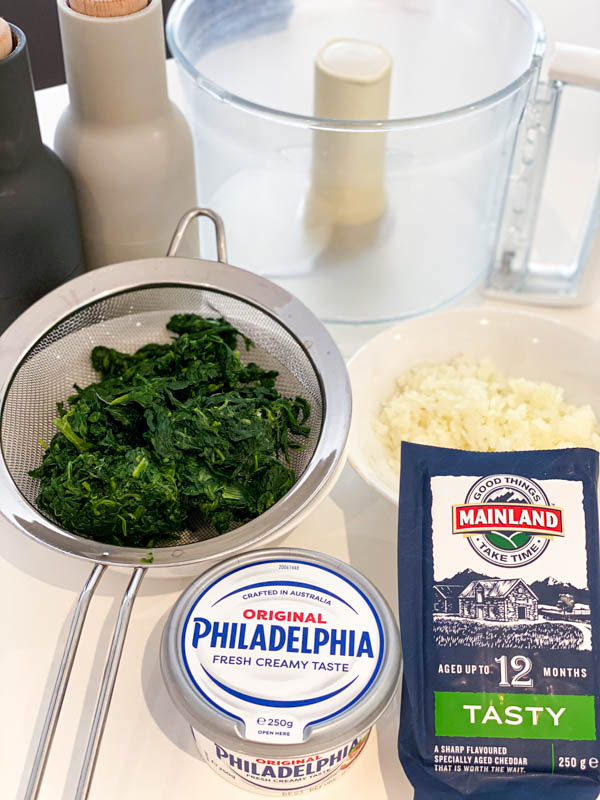 All the ingredients for the Spinach Dip are all on a kitchen bench.