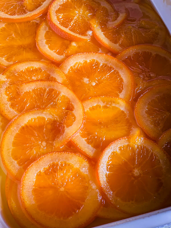 Close up of the confit orange slices that are soft and translucent.
