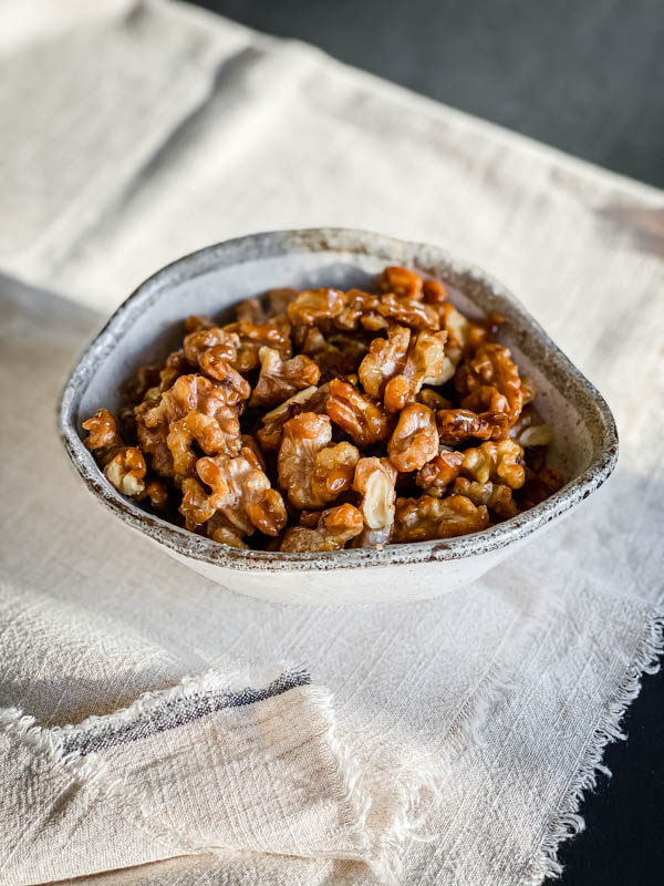 A bowl of ready to eat Candied Walnuts.