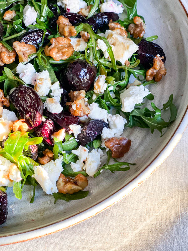 Close up of the Roast Beetroot, Goats Cheese and Walnut Salad on a large round white platter.