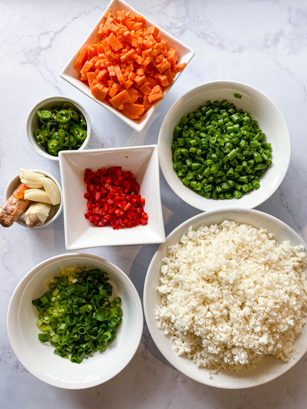 The vegetables for the Cauliflower Fried Rice are prepared, chopped and in bowls.