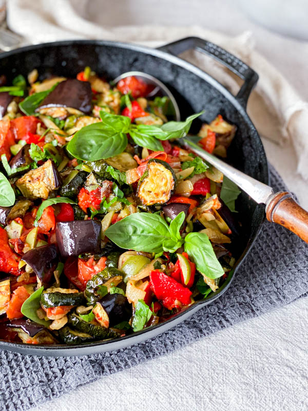 The pan of Roasted Ratatouille Salad with a serving spoon.
