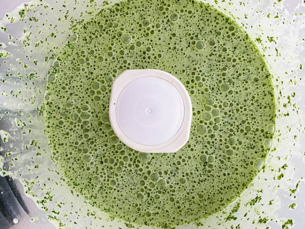 Looking into the bowl of the food processor with the now prepared Mint Dressing.
