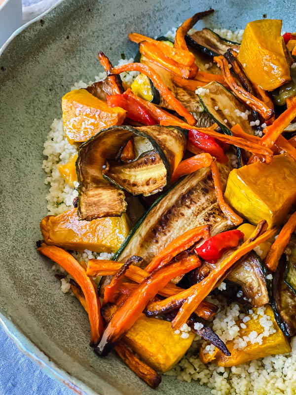 The grilled vegetables are sitting on top of the herby lemon couscous ready for the dressing.