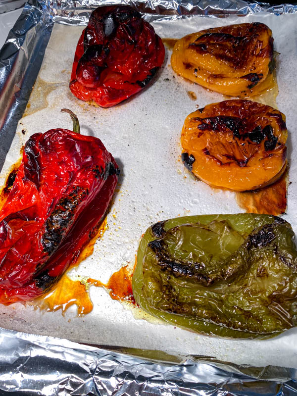 Grilled Peppers on an oven tray lined with foil and baking paper