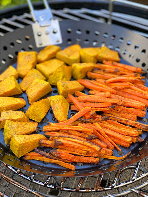 This shows the now roasted carrot and pumpkin pieces that are nicely cooked and slightly caramelised at the edges.