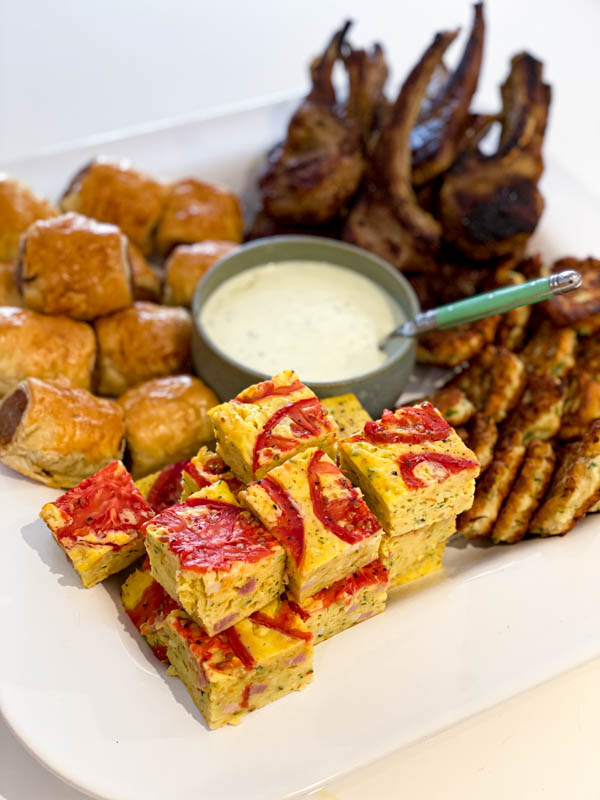 This shows the zucchini slice that has been cut into small squares that are served up as part of a share platter.