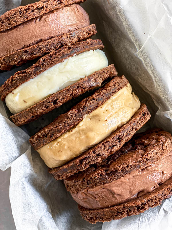 The cookies are made into ice-cream sandwiches which are pictured here on their side in a baking tin.