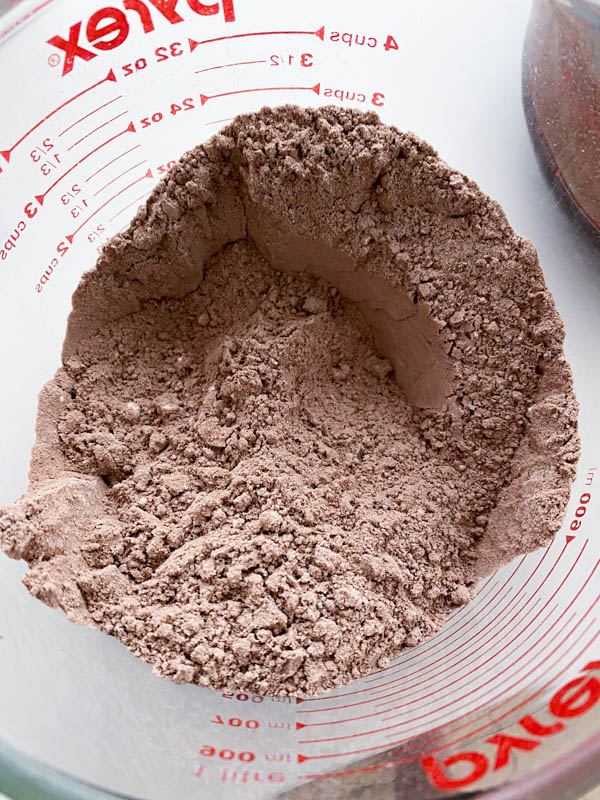 The dry ingredients have been sieved together in a bowl.