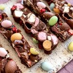 Slices of the Easter Rocky Road on a serving platter on a pink tablecloth.