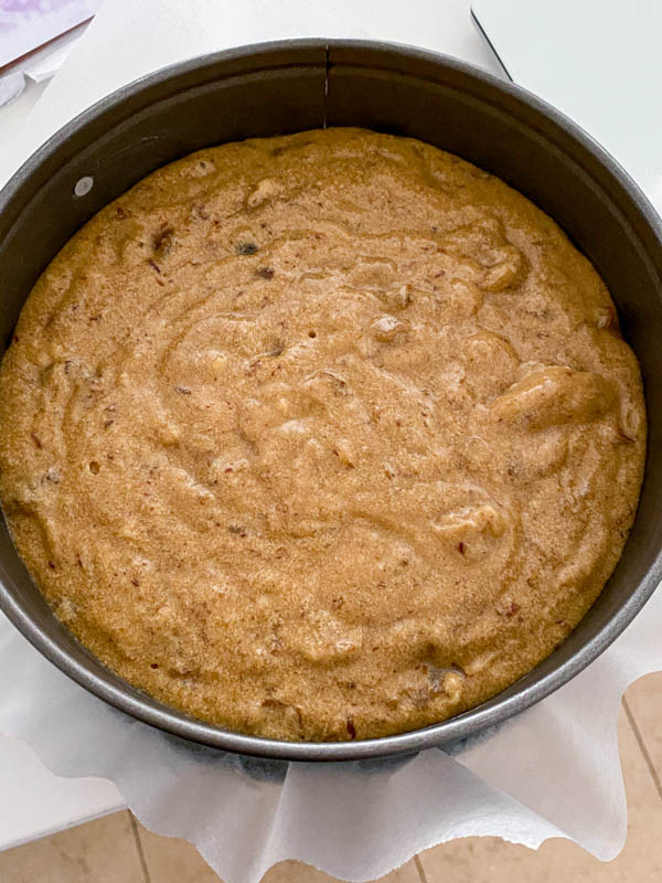 Looking down into the baking tin with the cake batter inside, ready to be put in the oven.