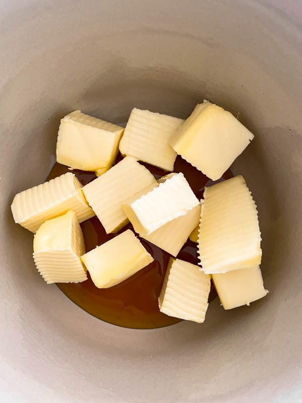 Cubes of butter and the golden syrup are in a saucepan ready to be melted.