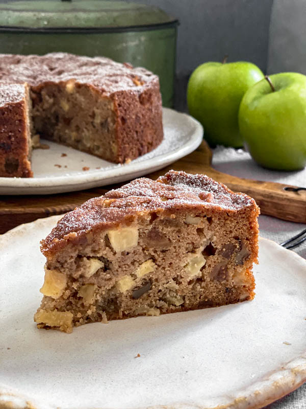 A close up of a slice of the Apple Fig and Walnut Cake.