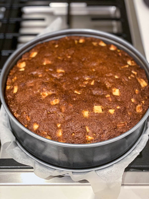 The cake is now baked and resting in the cake tin.