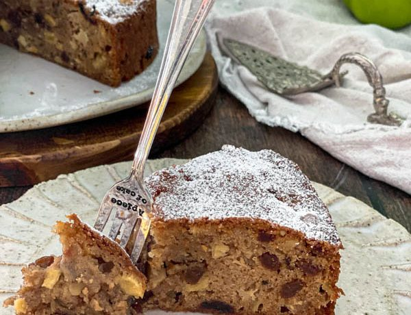 A close up of a slice of the apple cake.