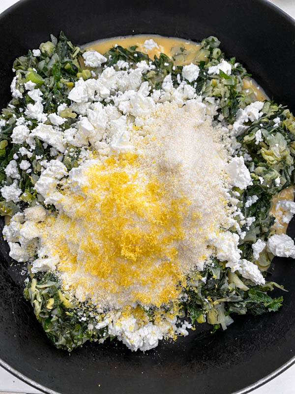 The 3 cheeses (ricotta, feta and parmesan), lemon zest and nutmeg are now added to the silverbeet mixture along with the eggs.