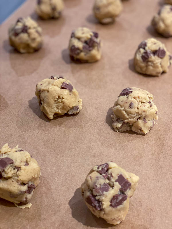 A close-up of the roughly shaped balls of cookie dough ready to be baked.