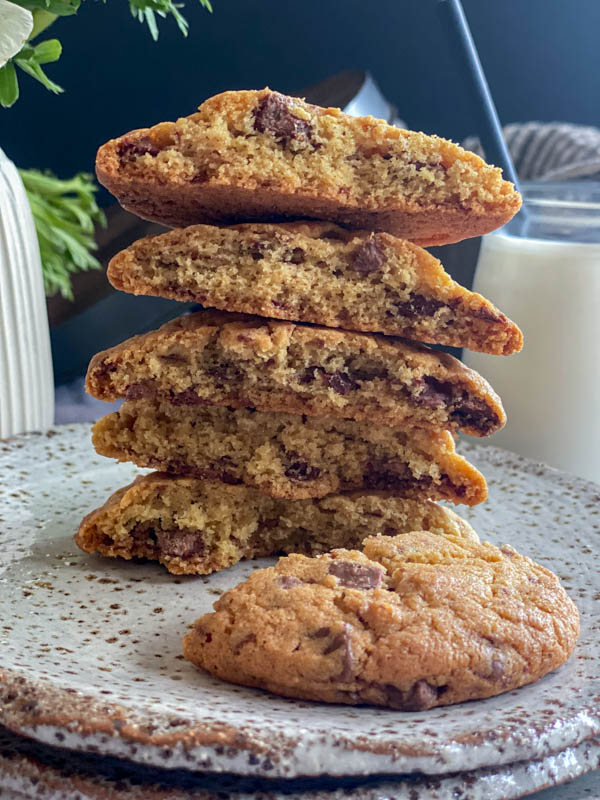 A close-up of the halved cookies showing the crumb and all the chocolate chunks inside.