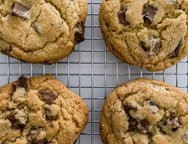 Looking down onto the golden chocolate chip cookies that are loaded with chocolate chunks.