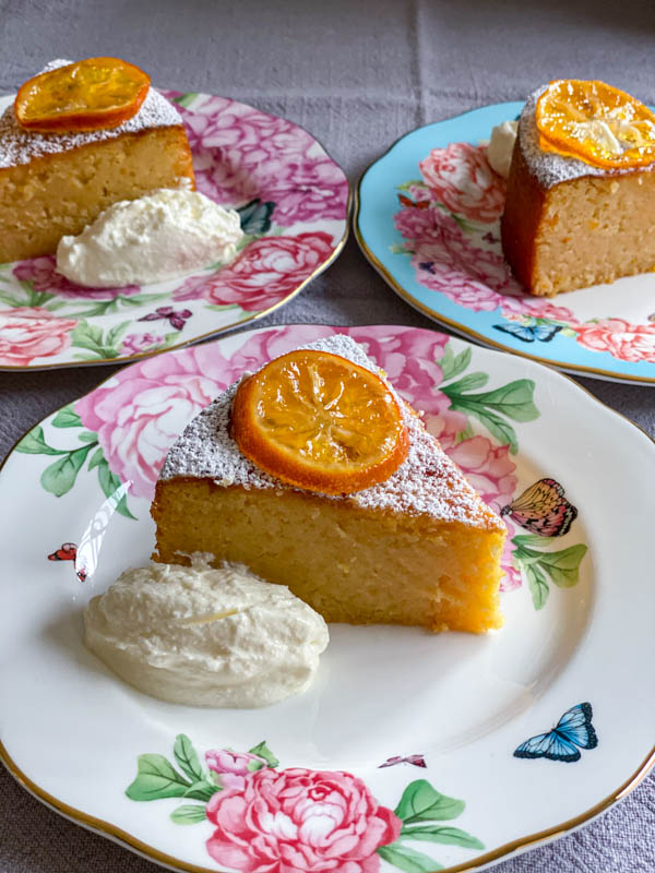 The lemon cake slices are on floral china cake plates.