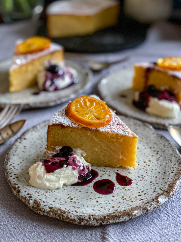 The lemon cake slices are served with a dollop of yoghurt and a good drizzle of blueberry and thyme compote.