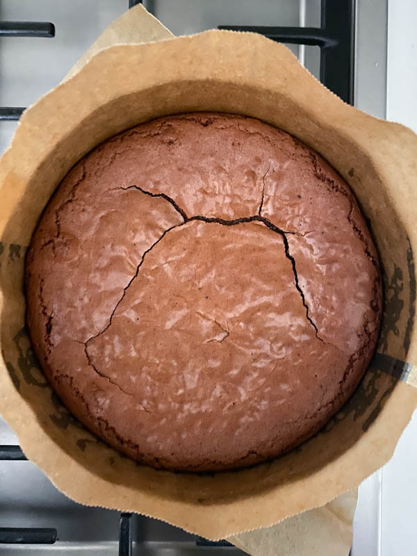 Looking down onto the baked brownie that is now resting in the baking tin until completely cooled down.