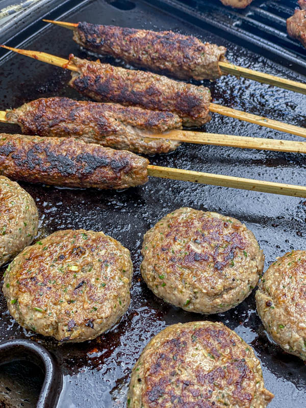 The kofta skewers and patties are nice and charred from cooking on a barbeque plate.